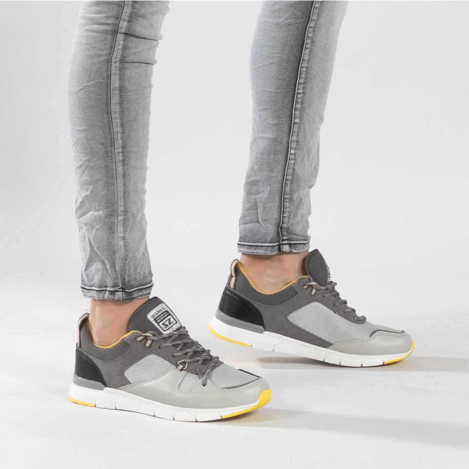 Ανδρικά γκρι αθλητικά παπούτσια με κίτρινες λεπτομέρειες it150319-28