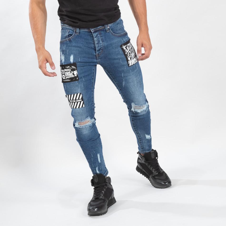 Ανδρικό γαλάζιο τζιν με σκισίματα και μπαλώματα it170819-48