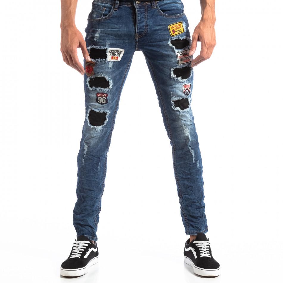 Ανδρικό μπλε τζιν Slim Jeans με διακοσμητικά μπαλώματα it260918-1