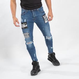 Ανδρικό γαλάζιο τζιν με σκισίματα και μπαλώματα