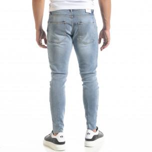 Ανδρικό γαλάζιο τζιν Slim fit με σκισίματα  2